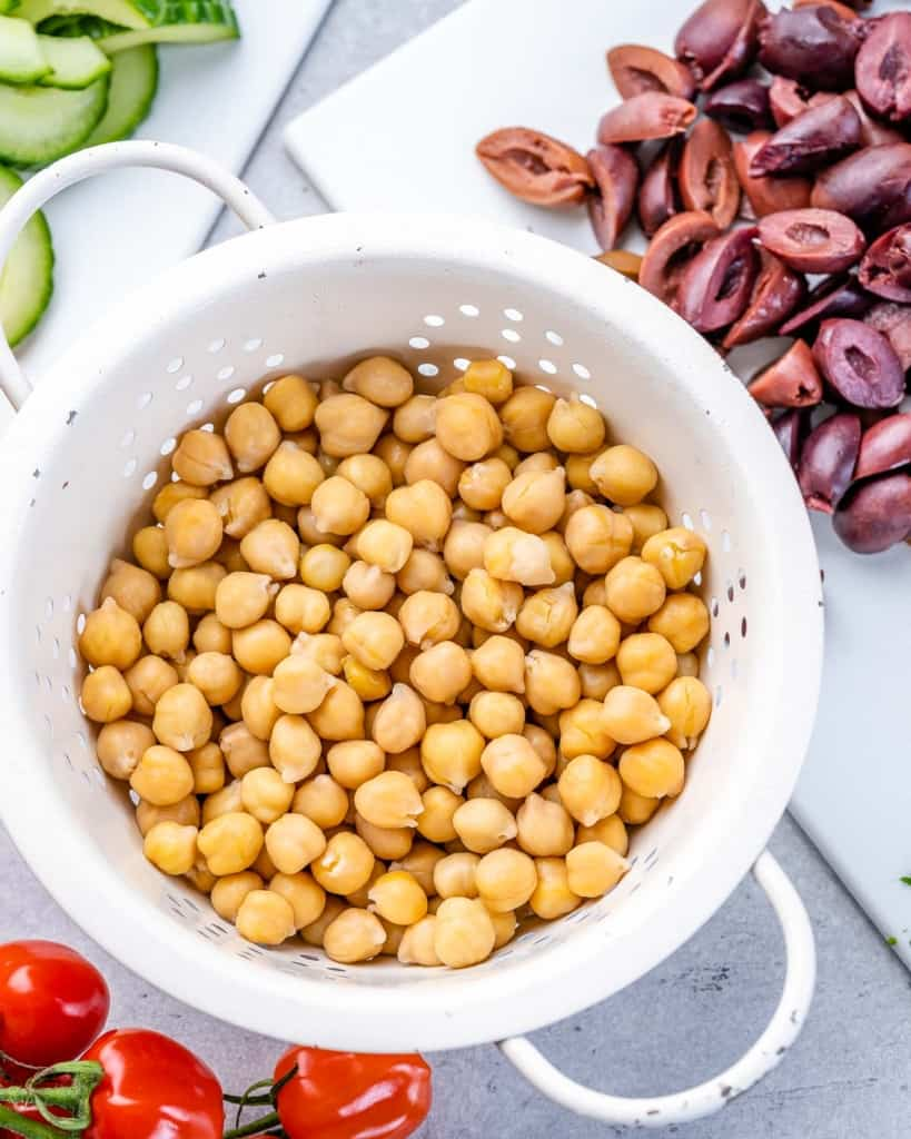 chickpeas in a bowl with sliced kalamata olives