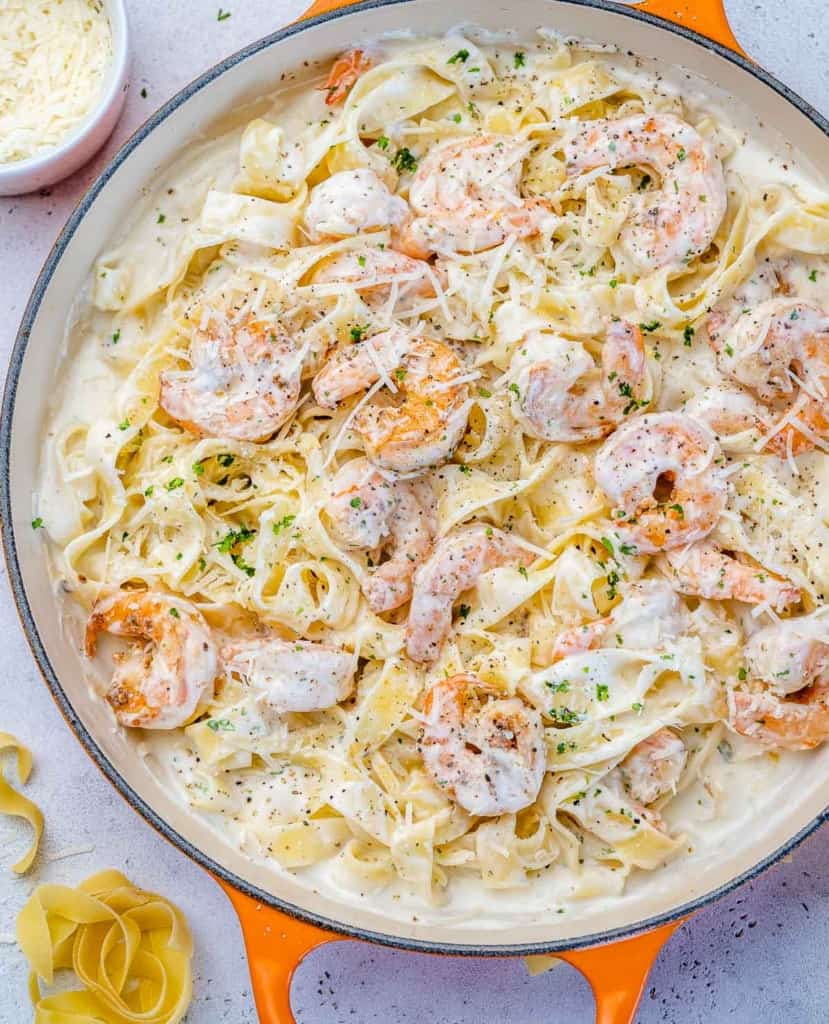 top view creamy shrimp alfredo in a pan