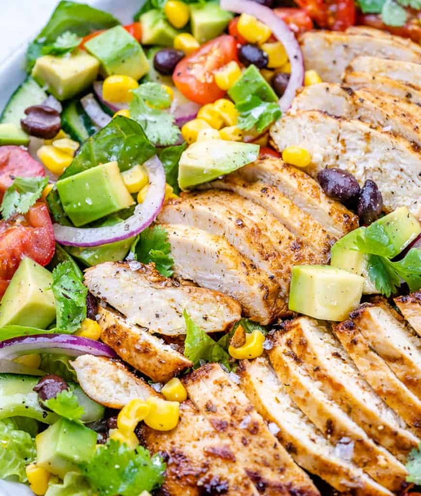 close up chicken salad in a white bowl