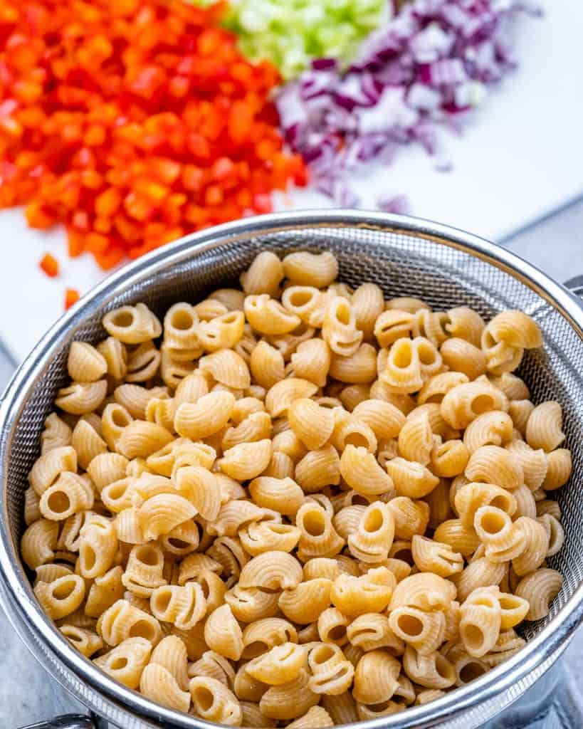 cooked pasta in a bowl for the macaroni salad
