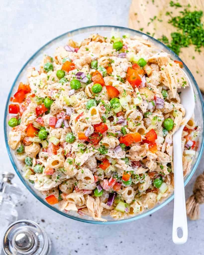 top view tuna macaroni salad with spoon in bowl.