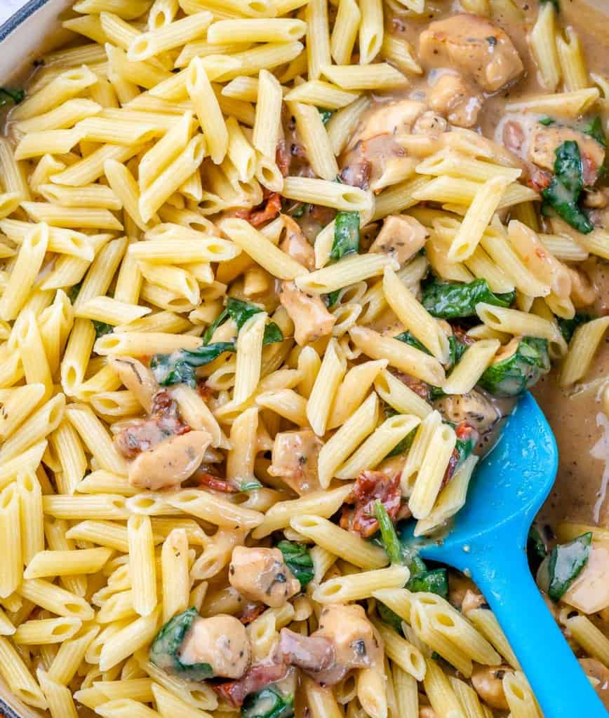 cooked pasta added to the creamy chicken sauce mix