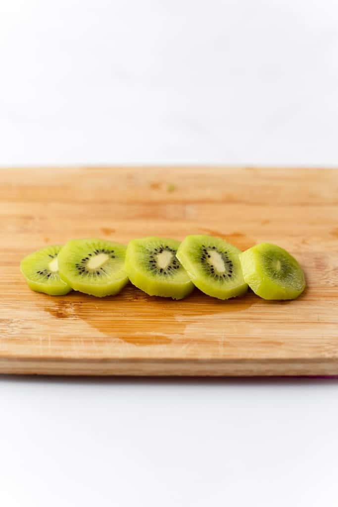 Kiwi cut into round slices.