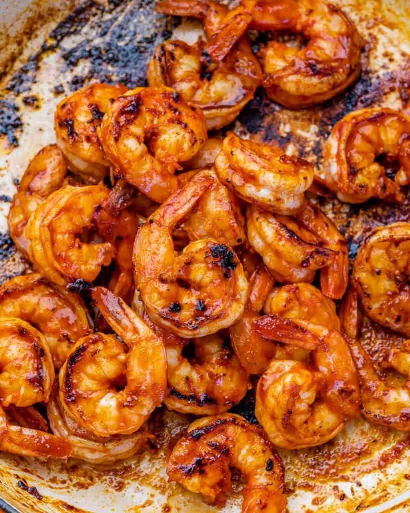 marinated shrimp cooked in a skillet