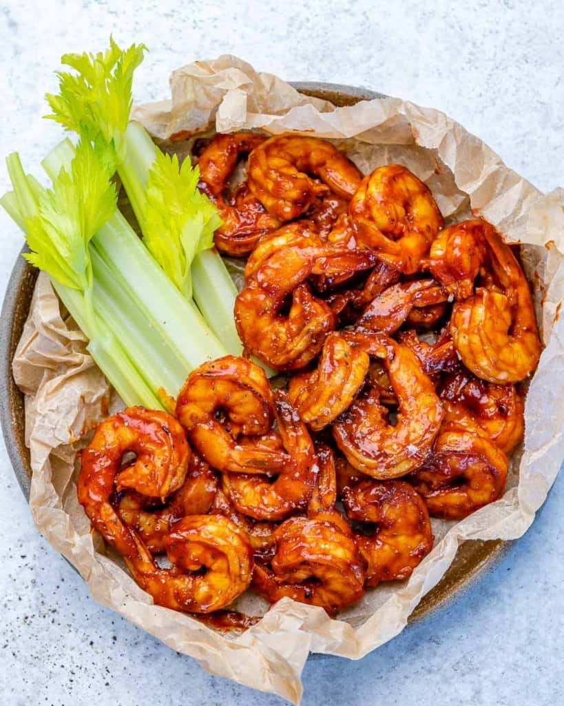 top view bbq shrimp with a side of celery