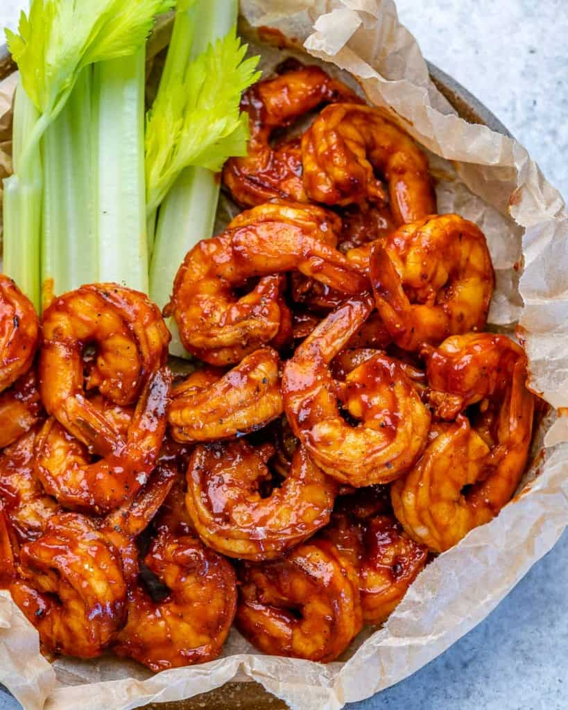 top view bbq shrimp with celery sticks on the side