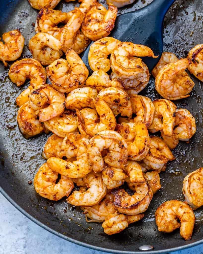 sauteed cajun shrimp on pan