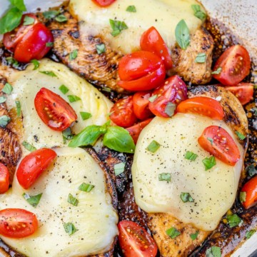 close up chicken caprese in a white skillet
