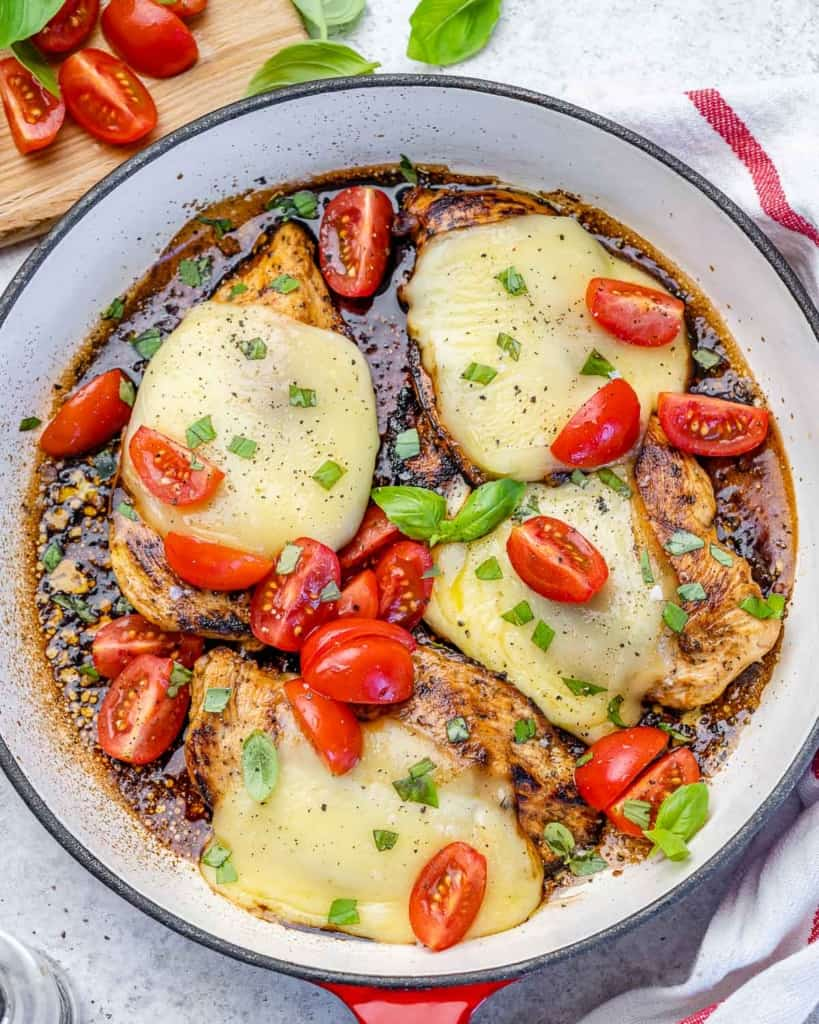 Chicken caprese in pan with tomatoes
