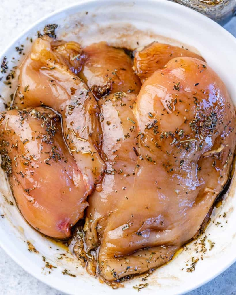 marinated chicken in a white bowl