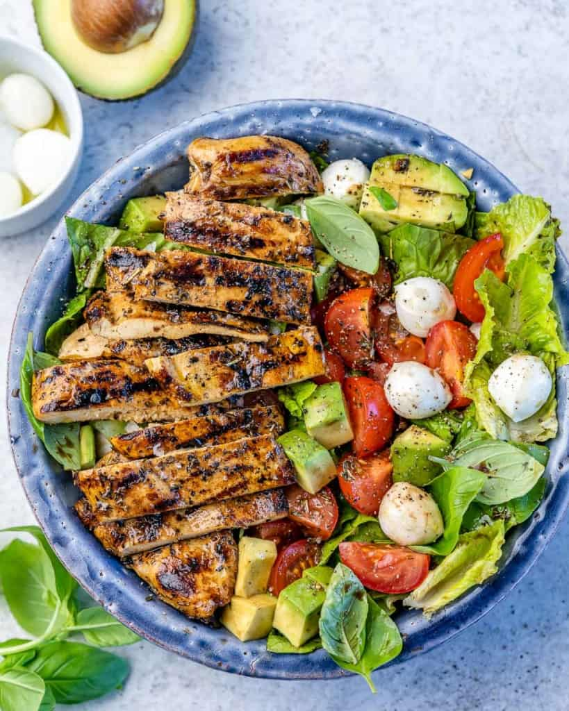 top view grilled chicken over caprese salad
