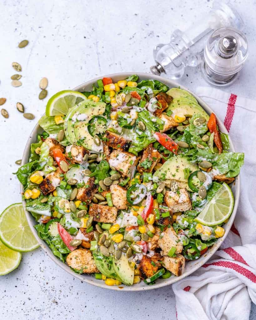 top view chicken chopped salad in a white bowl