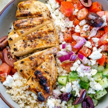 Close image of Greek chicken bowl with veggies