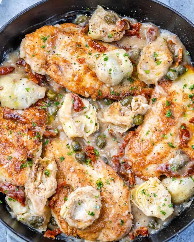 top view chicken breast in a creamy Mediterranean sauce