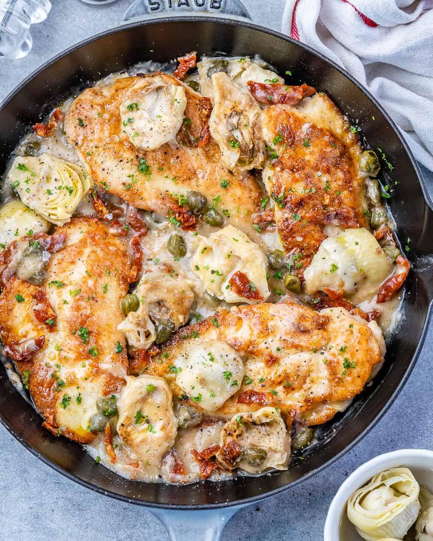 top view Mediterranean Chicken in a black skillet