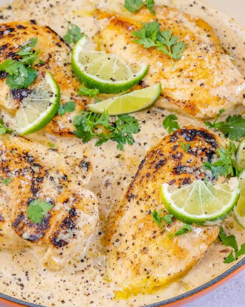 one pan of creamy chipotle chicken with limes and cilantro