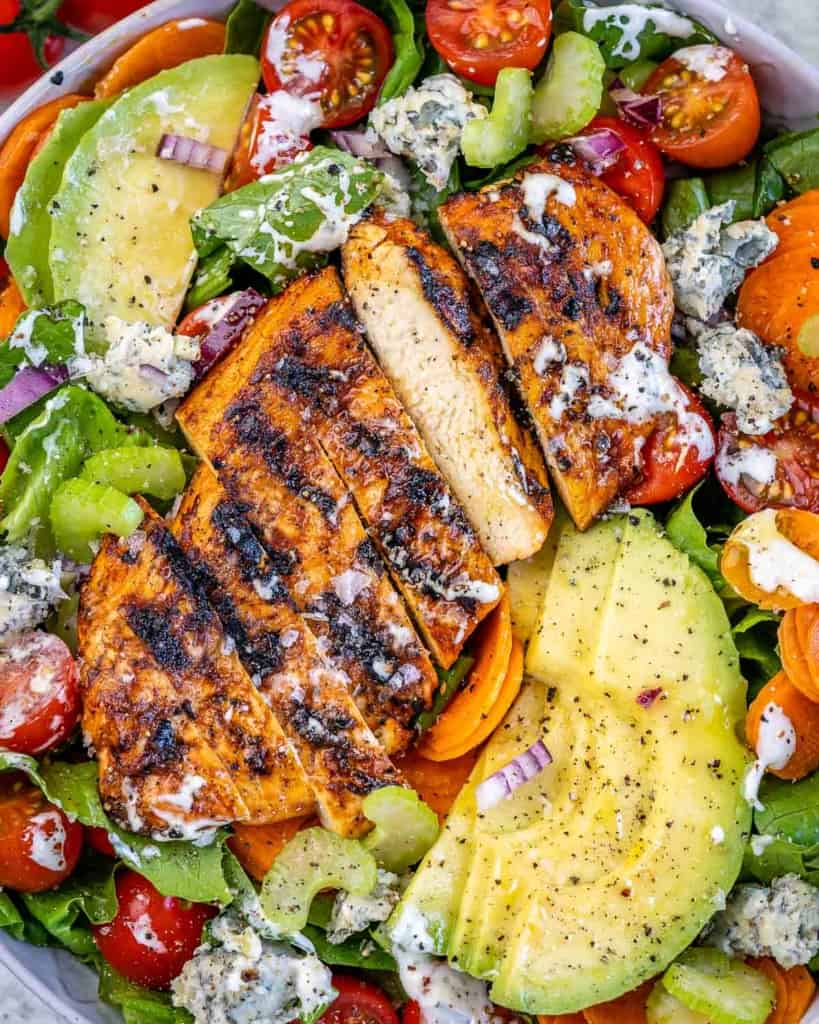 close up grilled chicken salad buffalo style.