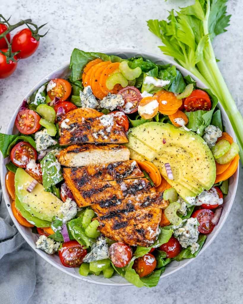 top view of salad with sliced grilled chicken breast