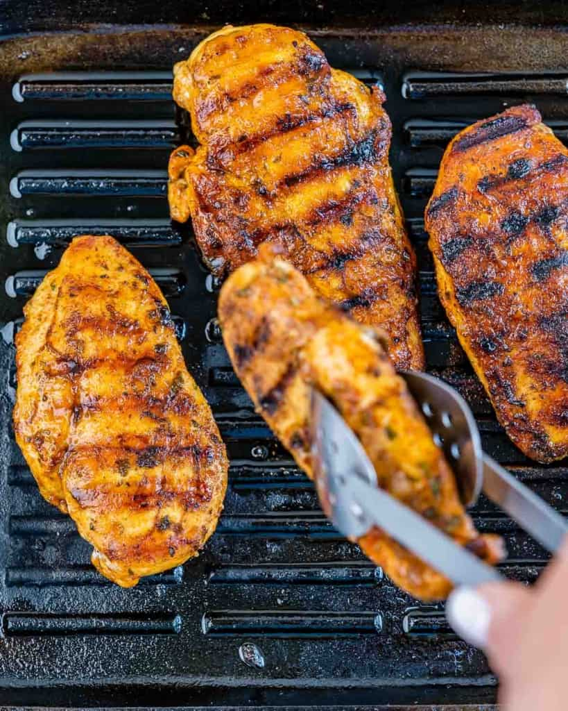 chicken breast being grilled on grill pan