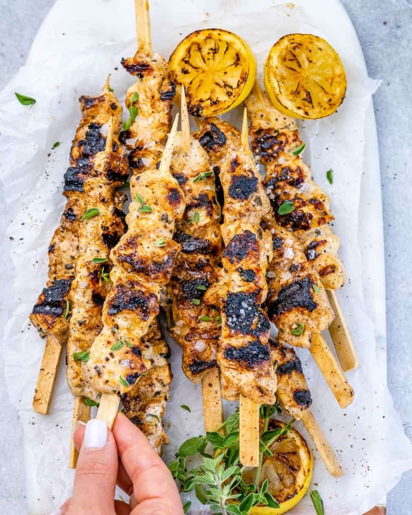 grilled lemon chicken skewers on top of white surface