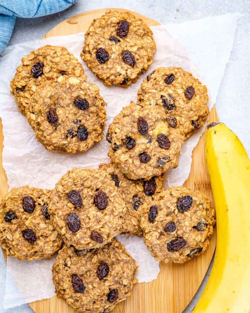 cookies on sheet pan with banana next to it on the right
