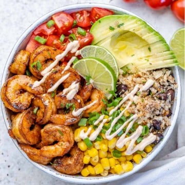 top view shrimp burrito with avocado, cauliflower rice, tomatoes, and corn