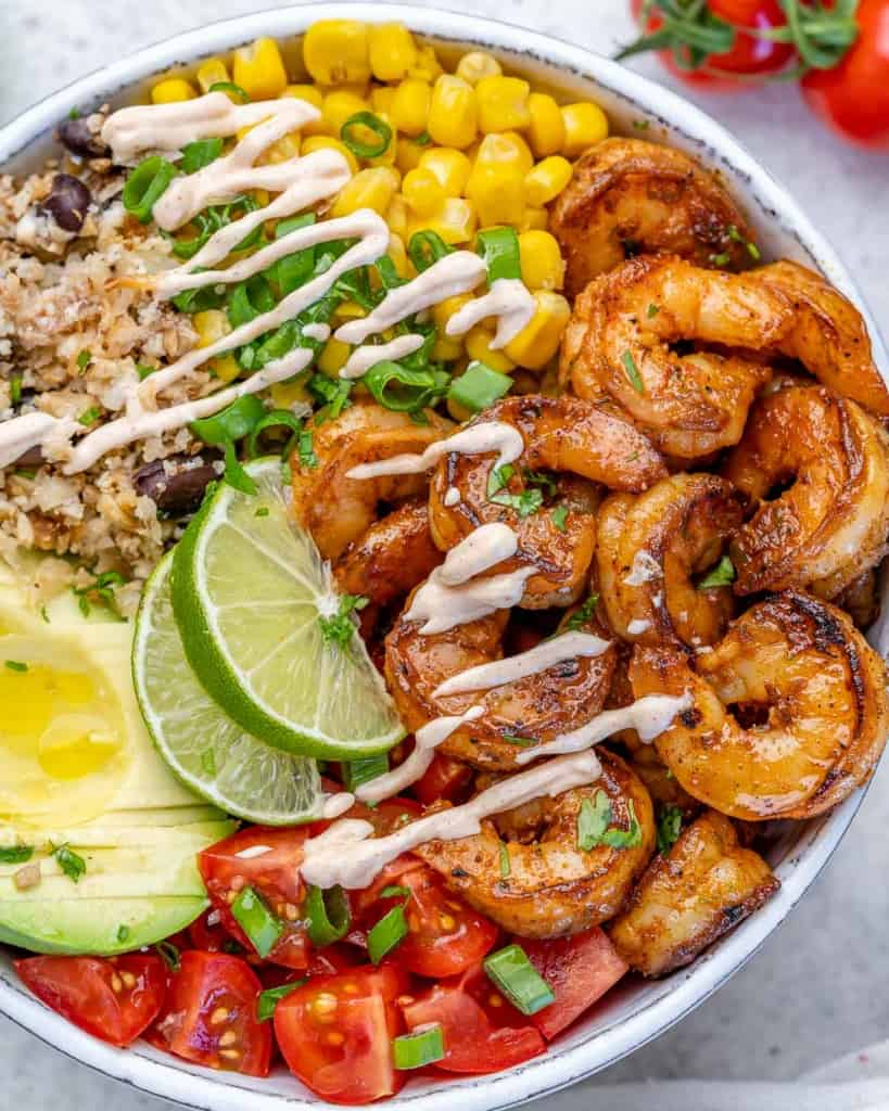 close up top view of burrito bowl with shrimp and cawliflower rice