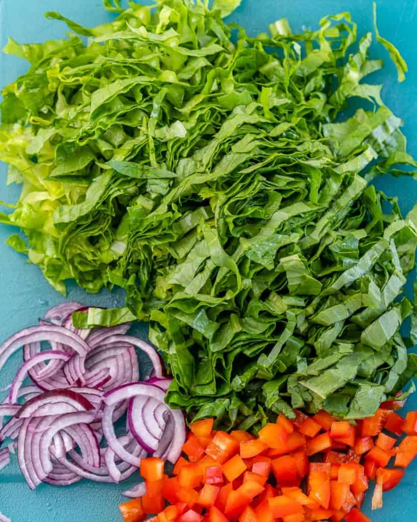 chopped lettuce, onions, and red peppers