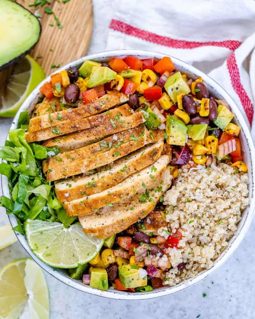 top view chicken quinoa taco bowl with sliced chicken breast and corn and bean salsa