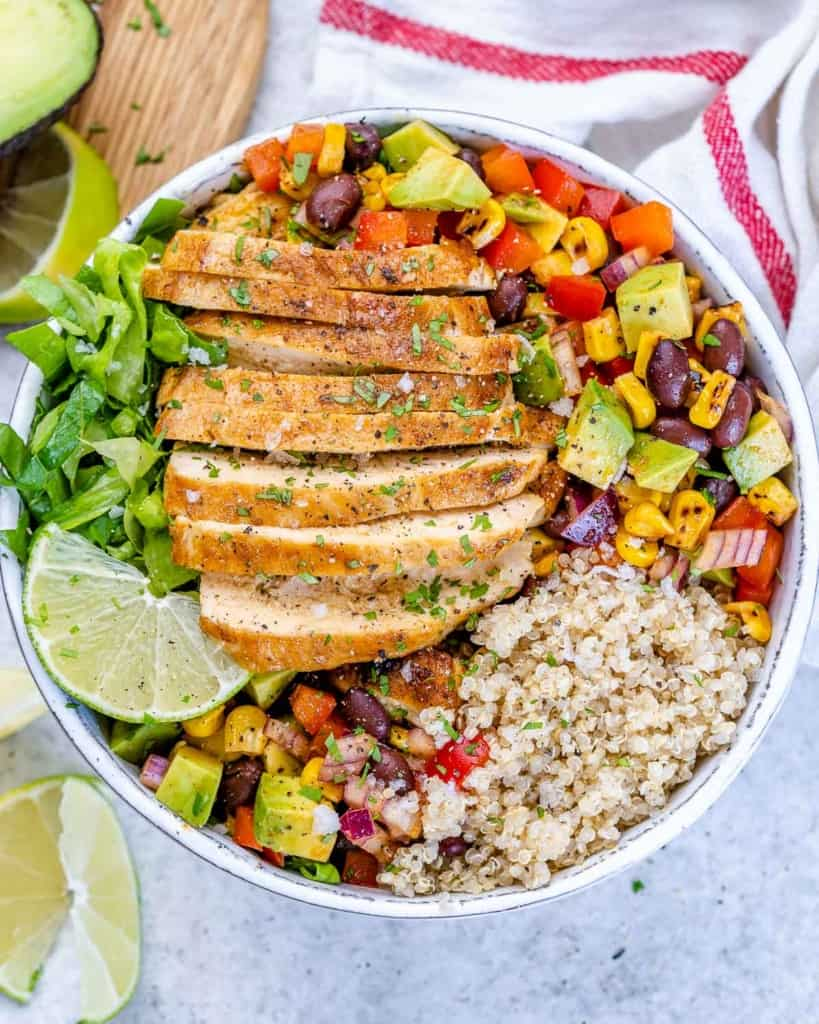top view taco grilled chicken in a white bowl with salad and quinoa