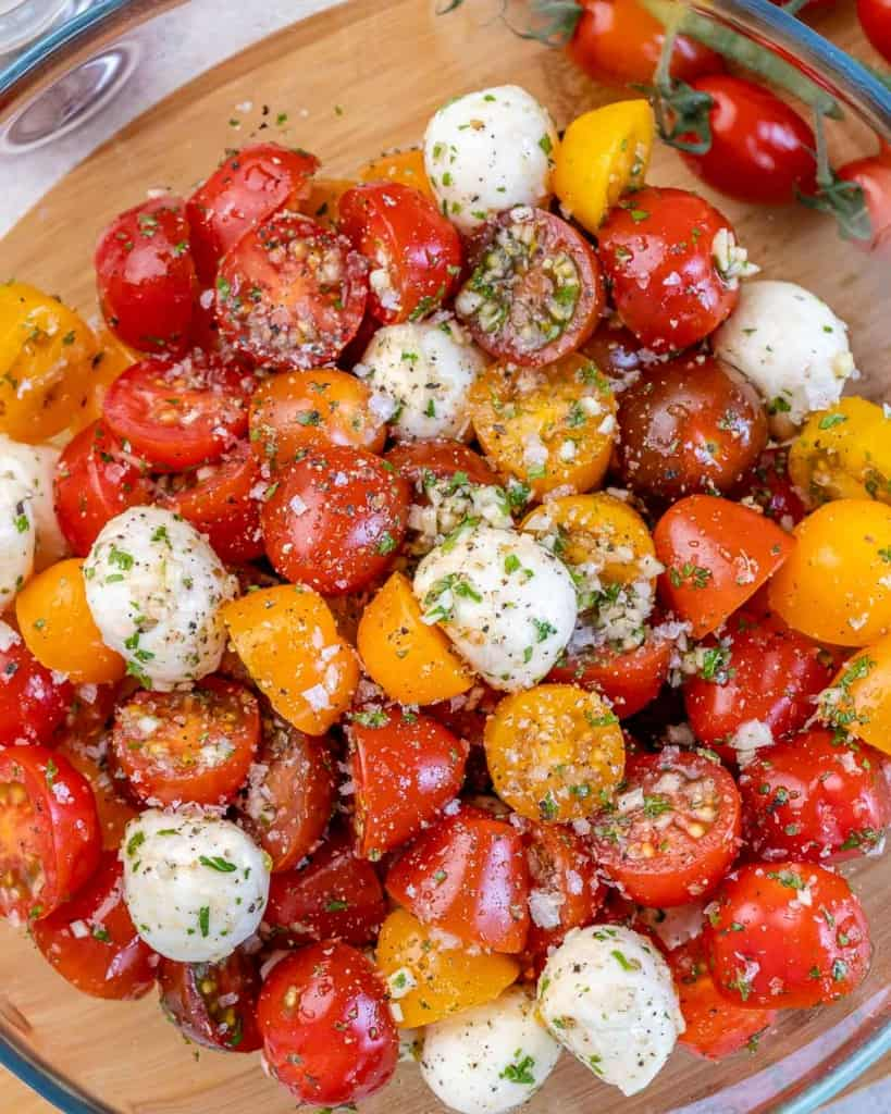 close up tomato salad with cheese balls