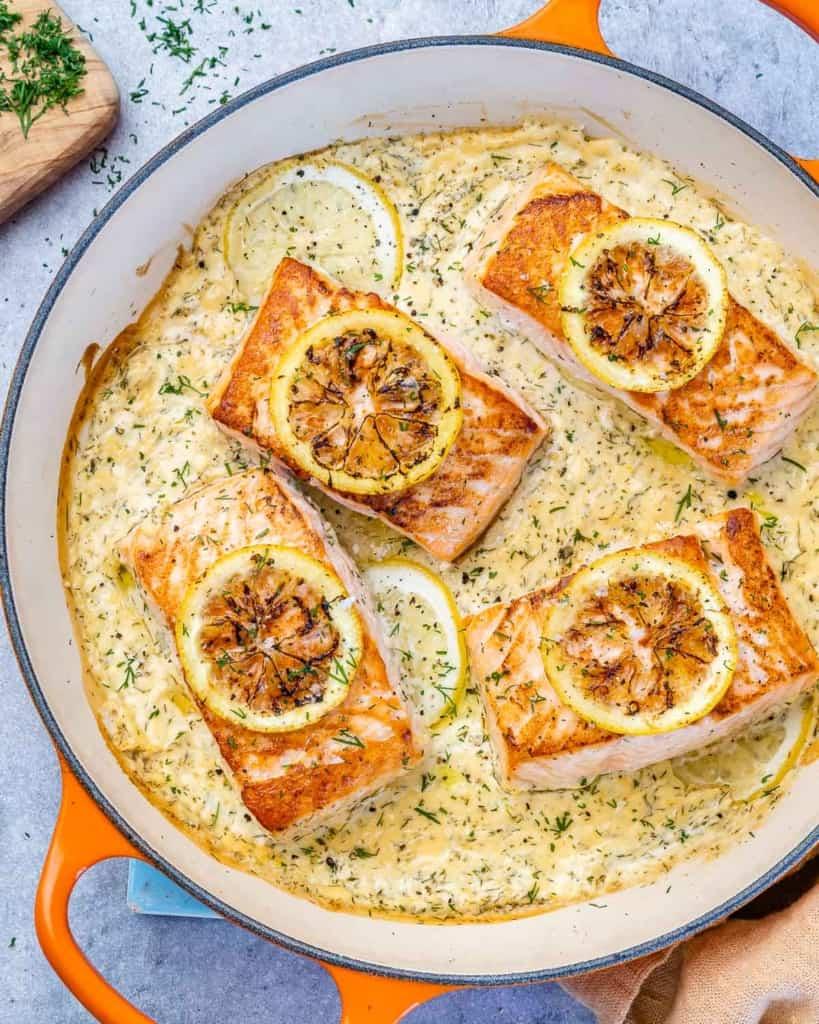 top view salmon filets in a creamy lemon sauce