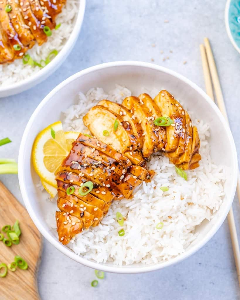 top view of teriyaki chicken with rice in a white bowl