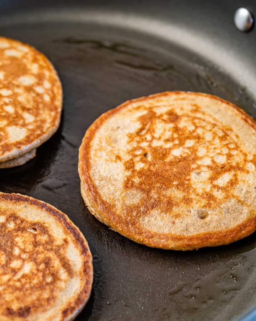 pancakes cooking on pan