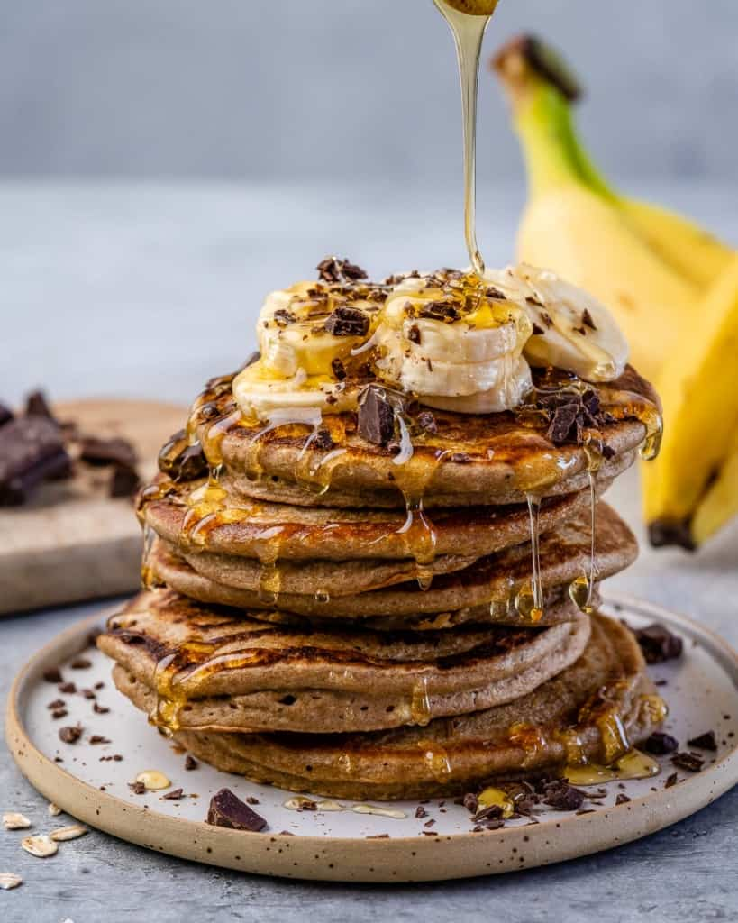 front stack of banana pancakes with syrup