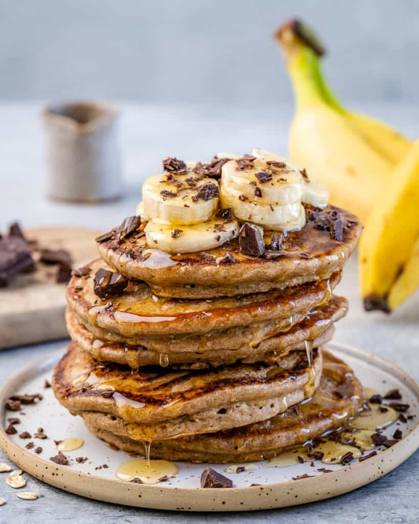 front stack of banana pancakes on plate