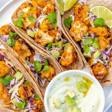 top view cauliflower tacos with sauce on the side