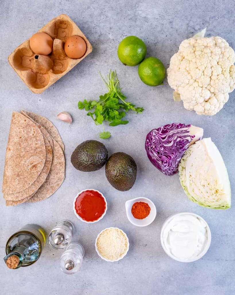 ingredients to make the vegetarian cauliflower taco laid out flat on a board