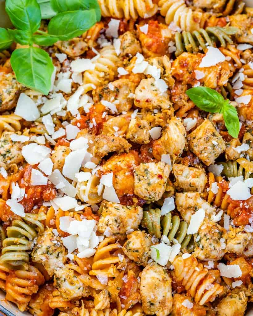 close up chicken bites with tomato based pasta
