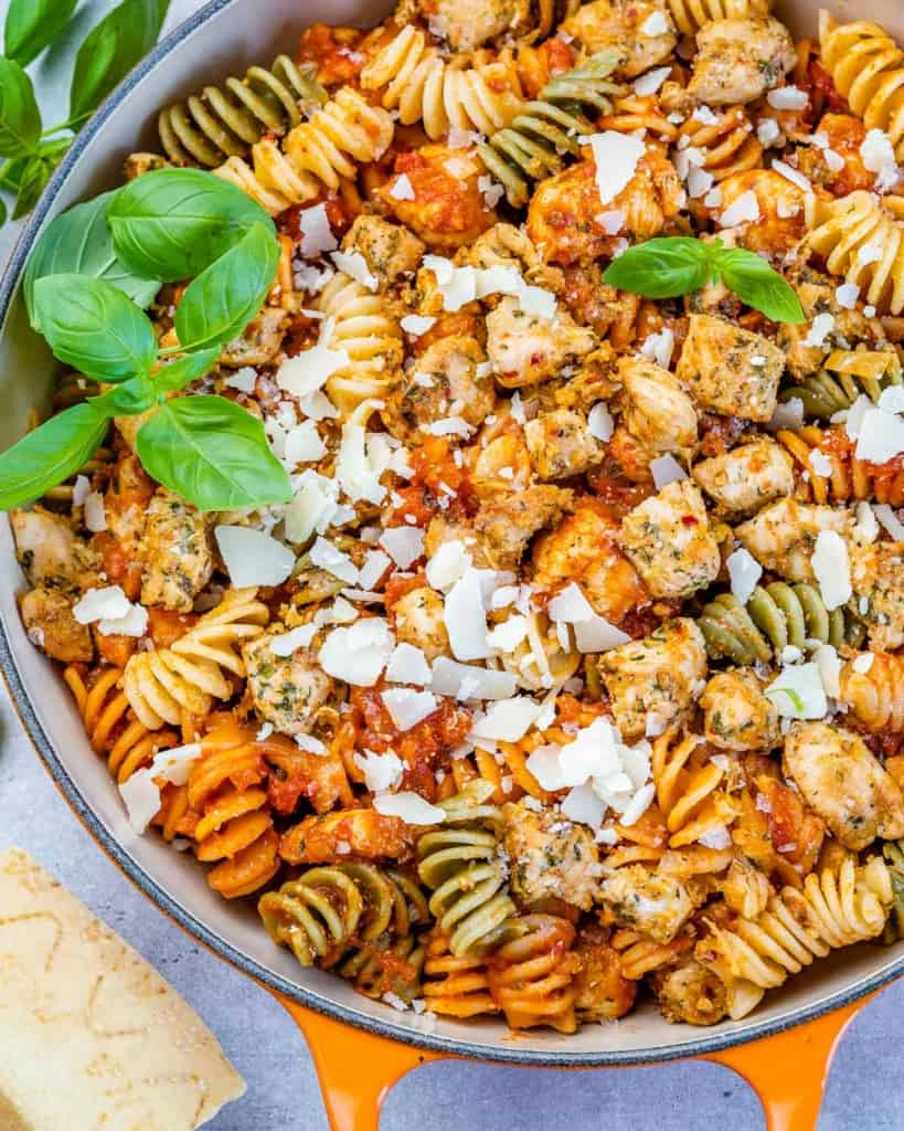 close up chicken parmesan pasta topped with shredded parmesan