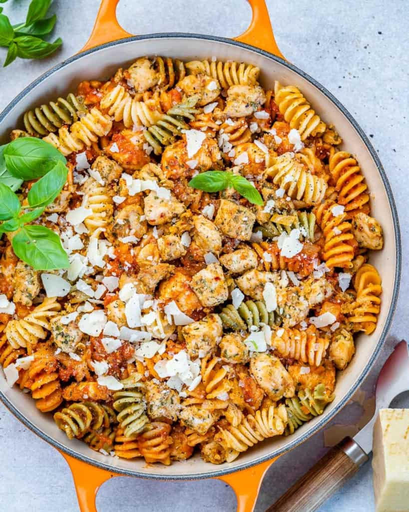 chicken pasta meal in an orange skillet