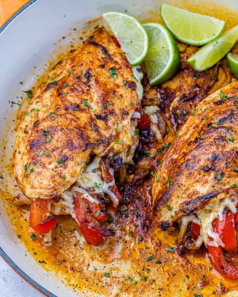 image of stuffed chicken breast in a white skillet