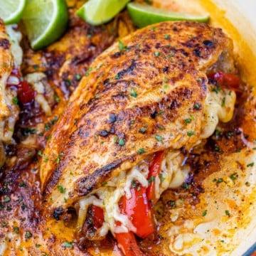 side shot of stuffed chicken breast in a pan