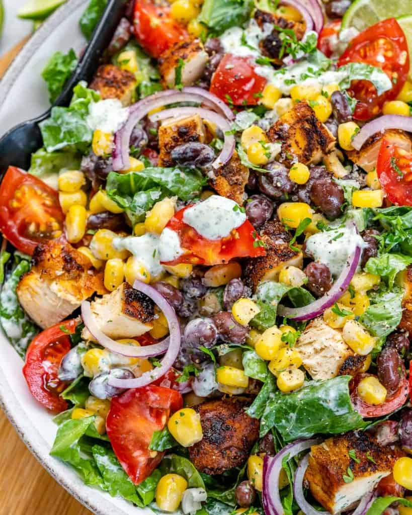 close up salad mixed in with dressing