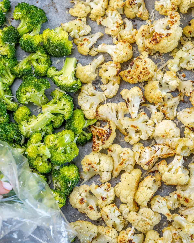 roasted broccoli and cauliflower florets separated on baking sheet