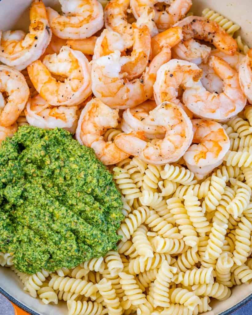 pasta, shrimp, and pesto added to pan