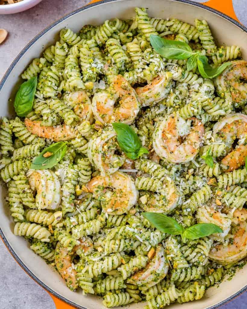 top view pesto shrimp pasta in skillet