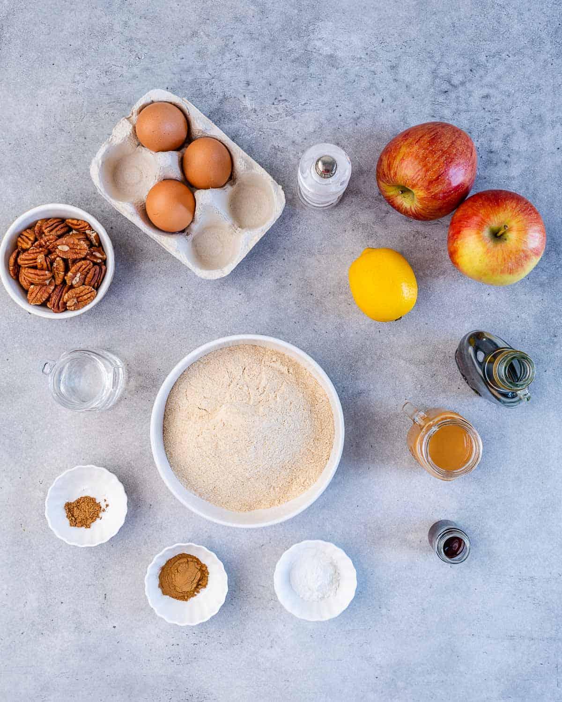 eggs, pecans, flour, apples, lemon, maple syrup, baking powder, cinnamon, all spice,