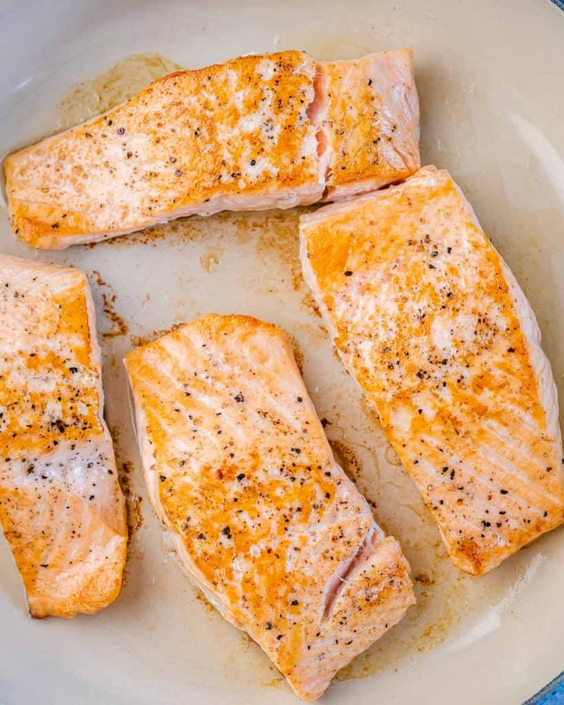 cooked salmon fillets in a pan