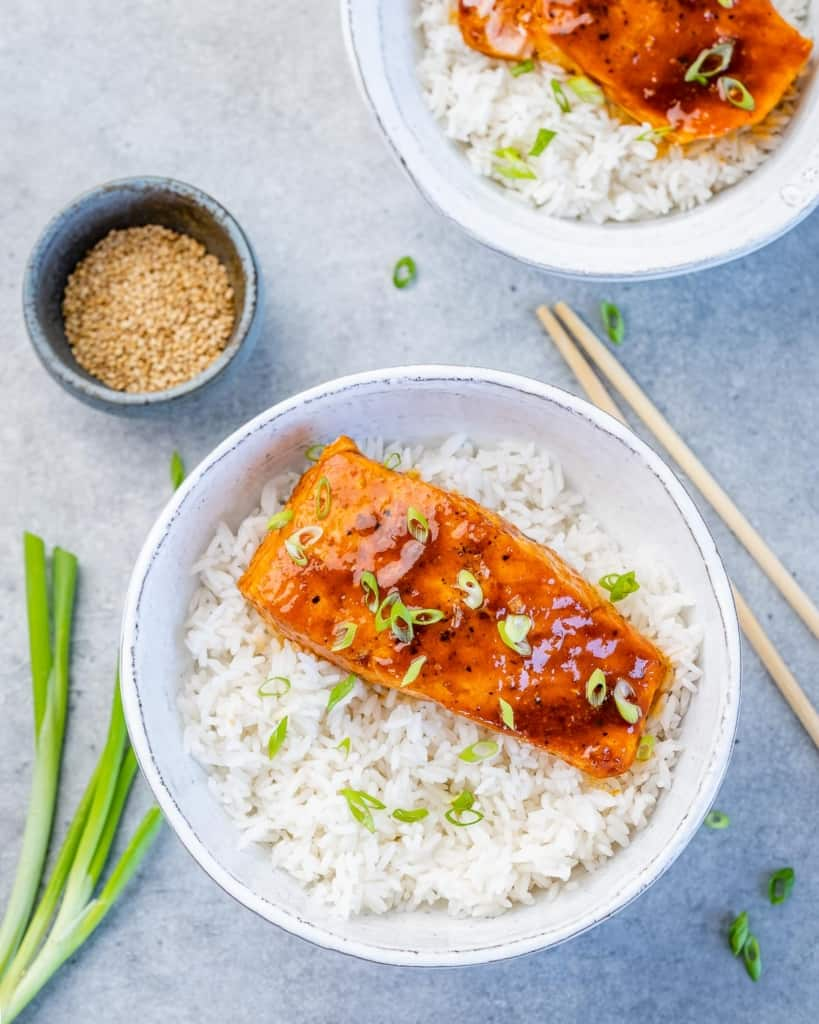 top view of honey salmon over a bowl of rice